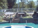 hardscape steps and pondless waterfalls in pool area